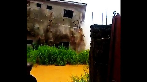 Video captures the incredible moment a house collapses in deadly flood