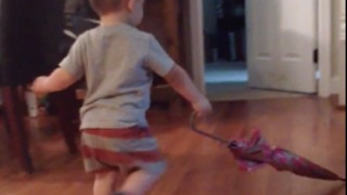 Don't own a push broom? Use an umbrella! : Toddler shows hard work ethic by sweeping floor with umbrella  - Video