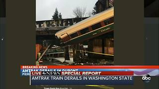 SPECIAL REPORT | Amtrak train car dangling over Washington interstate after derailment - Video