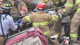 Building collapses with worker inside - Video