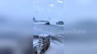 Dublin-bound traveller stranded in Glasgow Airport due to snow - Video