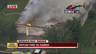 Crews with Hillsborough County Fire Rescue battle large house fire in Tampa - Video