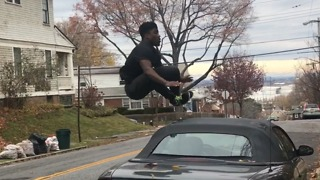 """A Guy Flips and Jumps Over Cars Saying """"It's Easy"""""""