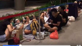 People Stare at Phones as They Camp Out Overnight for iPhone X - Video
