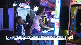 With spouses deployed, military families get arcade style Thanksgiving