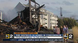 Fire Destroys 24 Homes in Condominium - Video