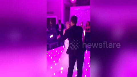 Groom slips and falls during wedding first dance