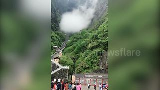 Stunning fog passes through China's famed Tianmen Cave - Video