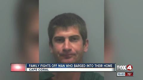 Fammily fights off man who barged into their home