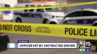Phoenix officer hit by distracted driver