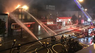 Firefighters Battle Blaze at African Arts and Drum Store - Video