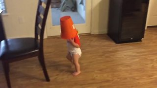 Toddler Runs Around The House With A Bucket On His Head - Video