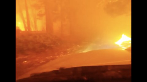 Man Fire Drives Through Camp Fire Flames in Northern California