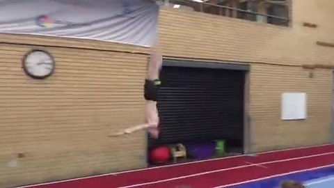 Young Gymnast Shows His Talent By Doing A Usual Gymnastic Routine