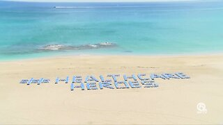 Singer Island resort spells out #HealthcareHeroes with beach chairs