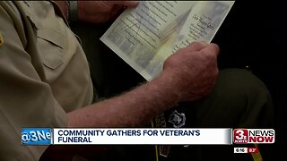 Community gathers for veteran's funeral