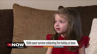 Child cancer survivor celebrating first Christmas at home