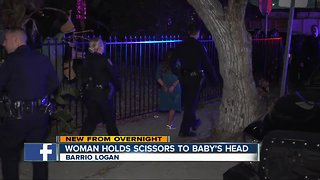 Police arrest woman who held scissors to baby's head