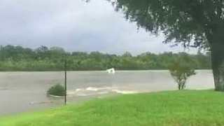 Structure Floats Down River as Beaumont, Texas, Floods - Video