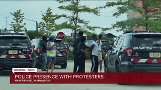 Police presence with protesters at Mayfair Mall