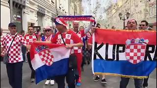 Croatia supporters march through the streets of Moscow ahead of England clash - Video