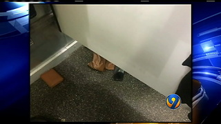 Teen catches peeper sliding cellphone under dressing room door  WSOC-TV - Video