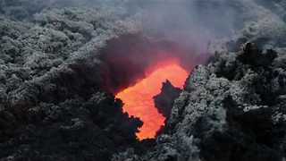 River of Lava Emerges From Etna Crater - Video