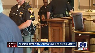 Tracie Hunter claims injury after being dragged from court