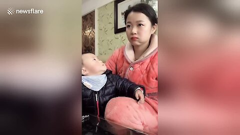 Mom Pretends To Watch TV To Avoid Being Caught Eating By Greedy Son
