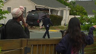 SUV crashes into Talmadge home