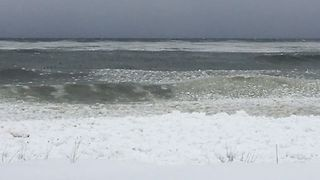 Lake Ontario's Waves Break Onto Snowy Shoreline - Video