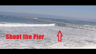 Daring Surfers Shoot the Ocean Beach Pier in San Diego During High Surf - Video