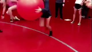 A Teen Boy And Girl Run At Each Other With Exercise Balls - Video