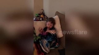 Sleepy toddler can't keep his eyes open while eating ice cream - Video