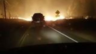 Couple Drives Through Edge of Wildfire Devastating Yuba County - Video