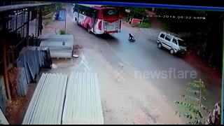 Lucky escape for scooter rider in bus smash - Video