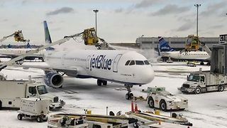 Travelers Face Delays After Wind, Snow Hits Boston Logan Airport - Video