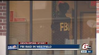 FBI raids Westfield financial services office - Video