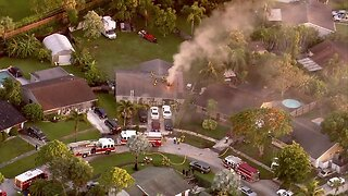 Firefighters battle house fire in suburban Lake Worth