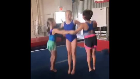 Girls show off their gymnastics triangle dance