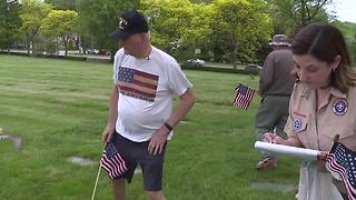 Veterans place flags on graves of fallen soldiers
