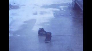 Sneakers Glide Down Icy Indiana Driveway - Video