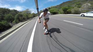 Daredevil skateboards down hill at insanely high speeds