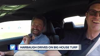 Jim Harbaugh does donuts on Big House turf - Video