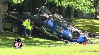 Man dies from injuries after crashing stolen police car - Video