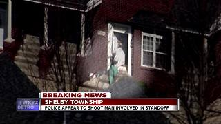 Police standoff ends in gunfire - Video