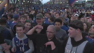 Fans chant Rock Chalk in Lawrence