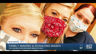 Family making and donating masks