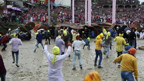Hindu devotees throw stones at each other to appease goddess