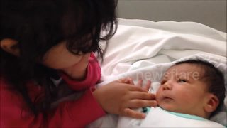 Sister meets her baby brother for the first time - Video